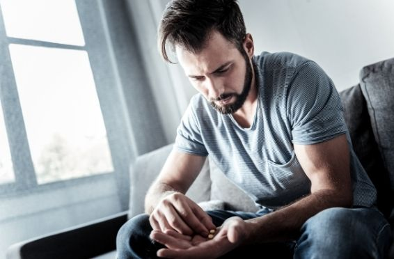 man experiencing withdrawal from drugs