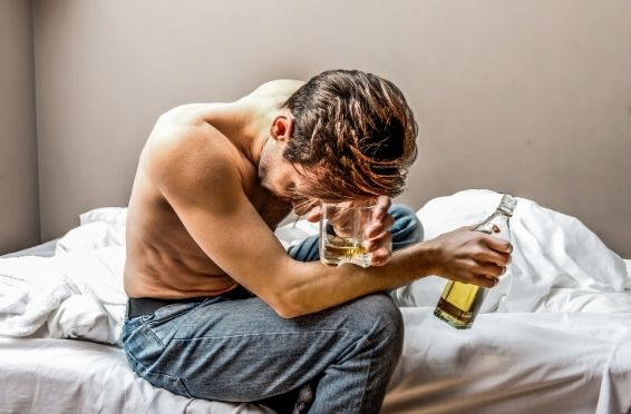 man struggling with alcohol addiction - need for Detox and Treatment concept image
